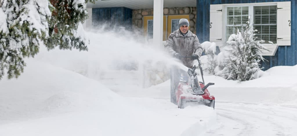 Person snowblowing their driveway